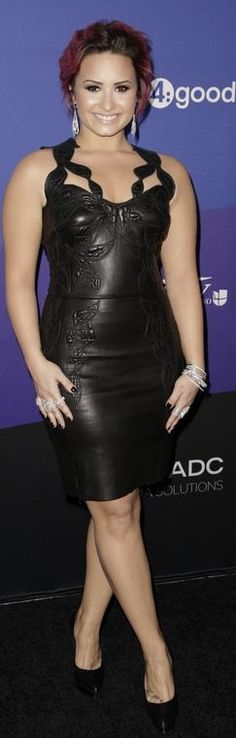 Who made Demi Lovato's black lace dress, platform pumps, and jewelry?
