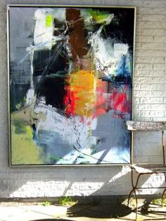 Large scale colorful painting in a neutral room. Perfect way to add a pop of color!