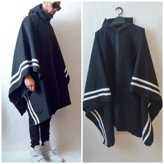 Hey All,  Please check out this awesome poncho. This is super cool hoodie poncho with border stripes for a cool contrast athletic look. It is new fresh approach to the poncho. Its a modern fashionable update to the traditional poncho cape  The color is black with white stripes. It has a nice shaped hoodie and zipper front and kangroo pockets.  Its drapes nice, so it can be worn in and out of the rain. It works well as a laying piece.  This is a one size fit all as the style is designed to be…