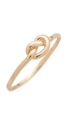 Ariel Gordon Jewelry Love Knot Ring. I would totally be happy with a simple engagement ring like this (someday).