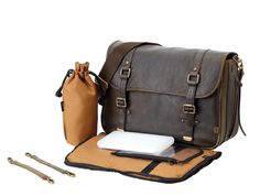 OiOi Baby Bags. Men's Chocolate Leather Satchel Diaper Bag. Even if you don't know what end is up, with this bag, you sure will look like you do. -j