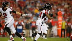 Devonta Freeman runs for 126 yards as Falcons hold off Buccaneers