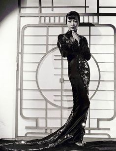 """Anna May Wong, who is considered the first Chinese-American movie star, is pictured here in Limehouse Blues, circa 1934. """"Images of Anna May Wong have appeared frequently in my scrapbooks,"""" John Galliano reveals in his interview with Andrew Bolton. """"The allure and mystique she projects are extremely powerful and seductive."""""""