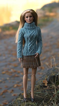 This knitting pattern can help you create a detailed aran sweater, like the ones pictured here. This fisherman-style Aran turtleneck is modeled after a beautiful sweater from Eddie Bauer. The cable pattern is complex, worked with small knitting needles. This pattern is for advanced knitters.