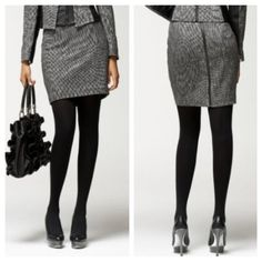 """Bebe Black Herringbone Pencil Skirt 8 Look like a boss at this office with this luxe suiting skirt from bebe. Made from the finest herringbone fabric, imported from Italy. Faux leather & elastic inset details at waist, exposed back zipper and fully lined.     size 8     31"""" waist   39"""" hips   19"""" length     51% wool, 23% polyamide, 20% cotton, 5% silk, 1% spandex    new with tags, but the faux leather at the sides has cracked in some places. See photo. bebe Skirts Mini"""