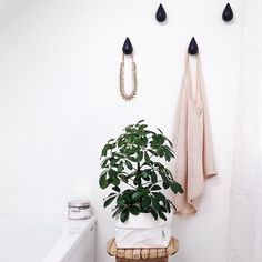 Drop it hooks from Normann Copenhagen used in beautiful bathroom surroundings | Photo credit @curatethisspace