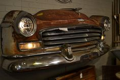 Oh.  Yeah.  Old car front mounted on the wall?  Husband would love it