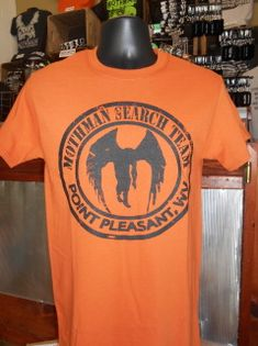 Our newest T-shirt design that is sure to turn heads with the large Mothman Search Team logo on the front and the map of the WV Ordnance Works (the TNT Area) on the back.    ​Color: Orange