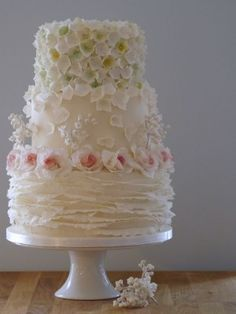 """""""True Romance"""" wedding cake ~ edible Hydrangeas, Lily of the Valley, Roses and Ruffles on this romantic wedding cake Beautiful Wedding Cakes, Gorgeous Cakes, Pretty Cakes, Amazing Cakes, Beautiful Desserts, Fondant, Ruffle Cake, Ruffles, Just Cakes"""