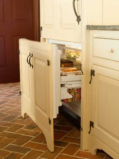 In designing kitchens for old houses, Kevin Ritter encourages the use of fully integrated appliances whenever possible. A large refrigerator can be given the appearance of an antique cupboard.