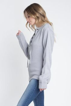 b9809ab422 This trendy sweater features a criss cross lace up detail on the neckline  Model is wearing a size Small Medium Cotton Acrylic Hand Wash Cold Imported