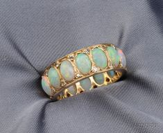 14kt Gold, Opal, and Diamond Band, set with fourteen cabochons, single-cut diamond melee highlights