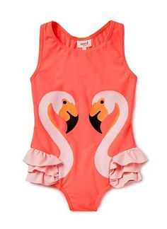 Nylon/Elastane blend Bather. Full bathing suit with flamingo placement print on front and racer style back. Features novelty feathers with double layered frill on side. UPF 50 rating. Neat fitting silhouette. Available in Pink Sunset.