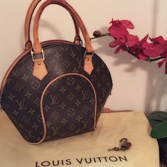 OBO Authentic Louis Vuitton Eclipse Handbag Absolutely gorgeous Louis Vuitton handbag light patina on the handles inside is very clean comes with lock two keys dust bag and handbag Louis Vuitton Bags Satchels