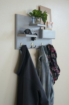 Keep your home stylishly organized with this Midnight Woodworks original design. Our handcrafted shelf and hook entryway organizer is an excellent entryway storage solution. Perfect for mail, keys, coats, backpacks and other necessities! This custom built flush-mount organizer is made using solid wood stained or painted with your choice of color. Four antique brass double coat hooks provide storage for your bags, backpacks and other necessities...and theyre strong enough for your heaviest…