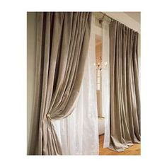 This is the basic idea of layering, a sheer white to let the light in, and a blockout curtain over the top, to keep out light, cold and heat.