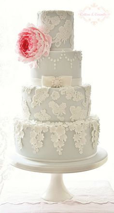 Lace themed wedding cake with pink flower. #weddings #cakes #hawaiiprincessbrides