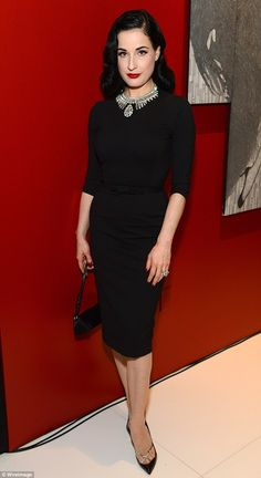Bedazzling! Dita Von Teese plays the vamp in retro pencil skirt and sweater set at BritWeek Awards