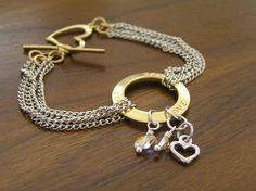"A brass ""Love"" washer takes center stage in Artbeader KMR's multi-strand bracelet."
