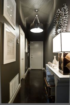 Love this. The dark grey doesn't make the hallway look narrow.