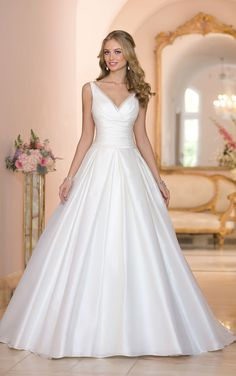 Stella York - Domani. Sweetheart neckline and back are lined with a soft Organza accent. Horizontal ruching at the waist, skirt fans full with the help of tailored box pleating.