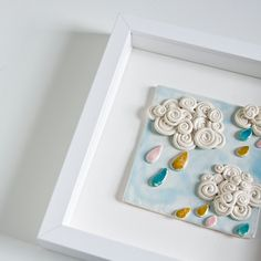 Curly Clouds, ceramic tile, framed 3d kids artwork in pastel shades, baby and childrens' bedroom wall decor, READY TO SHIP. €66,00, via Etsy.