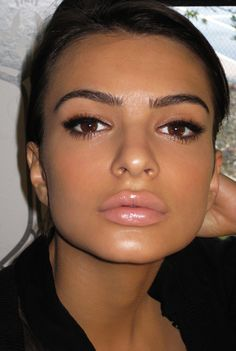 nude/pale pink lipstick is delightful with dark eye makeup and the right dress  Not a fan of the glossy lip look but her eyes are gorgeous.