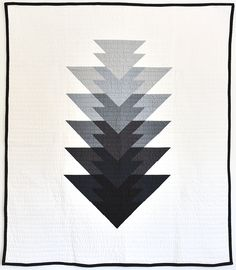 A new color-way has been listed in the shop for the Arrowhead quilt - Grey!  Made with Kona Cotton Iron, Titanium, Graphite, Charcoal, Pepper and Black  on the front and Carolyn Friendlander's black crosshatch on the back. The  grey arrowhead is great neutral to compliment any home or nursery. xo