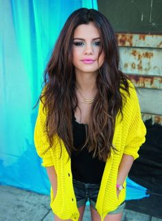 Selena Gomez. Love the neon cardigan. This is probably the best photo I have seen of Selena, so natural.