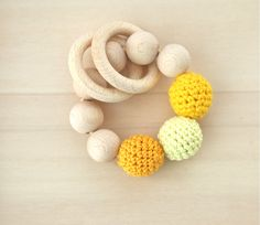 Teething toy with crochet wooden beads and 2 wooden rings; rattle.. $17.00, via Etsy.