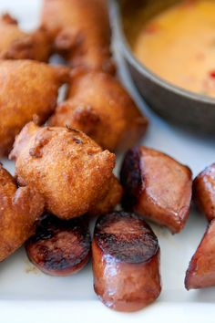 Pickled onion hush puppies with pimento cheese queso and andouille sausage at the Delta Bistropub. (Photo: Robert Rausch for The New York Times)