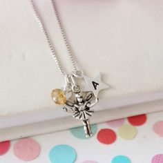 This delicate sterling silver fairy charm necklace can be personalised with alphabet charms and a November birthstone gemstone to celebrate the life of a child. Gemstone Bracelets, Gemstone Necklace, Crystal Necklace, Birthstone Charms, Birthstone Necklace, Topaz Jewelry, Jewellery, Alphabet Charms, November Birthday