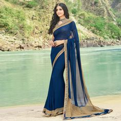 Buy Navy Blue Casual Printed Georgette Saree online in India at best price.This fancy casual wear saree in blue color is designed using georgette fabric which has been detailed Indian Fashion Dresses, Dress Indian Style, Indian Designer Outfits, Indian Outfits, Trendy Sarees, Stylish Sarees, Fancy Sarees, Indian Beauty Saree, Indian Sarees