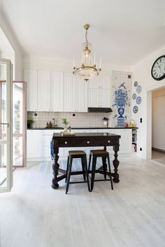 white kitchen with a touch of blue