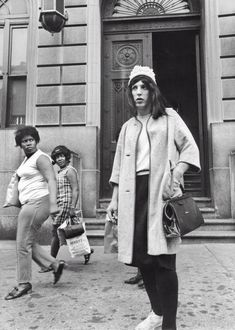 1969: This photo, taken the same year as the Stonewall Riots, shows a similar plan in NYC. This drag-wearing cop might actually have been part of the raids.