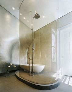 Stunning glass curved shower wall.