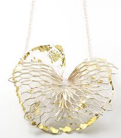 "Necklace | Maria Tsimpiskaki .  ""Dissolution"".  ER6 PVC, silver plated brass, sterling silver, 22k gold foil"