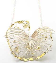 "Necklace | Maria Tsimpiskaki .  ""Dissolution"".  ER6 PVC, silver plated brass, sterling silver, 22k gold foil"