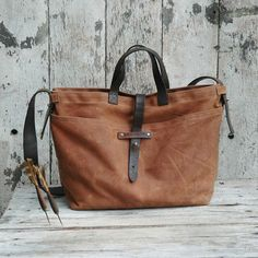 Still on the hunt for the perfect bag - this one's pretty awesome! Waxed Canvas Tote with antique leather and fabric by PegandAwl