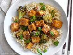 This Pan Fried Sesame Tofu is seriously crispy and drenched in a tangy sesame sauce. Broccoli florets and cooked rice make it a meal. Step by step photos.