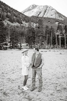 Fall Engagement Session - Black and White - Outdoor - Red Lodge - Montana - Mountains - Engaged Couple - Fiancé - Man - Woman - Trees - Jeans - Jeggings - Rancher Hat - White Boots - White Sweater - Denim Shirt - Carhartt Vest - Montana Wedding Photographer - Sara Nagel Photography
