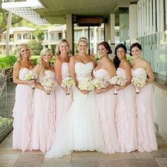 One fabulous @morileeofficial bride and her petal pink bridesmaids. The blushing bride is wearing Blu style 5108.