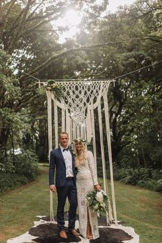 I'm liking the macramé trend and, pending the dress style, this could look pretty fabulous strung between the locust trees with some floral accents.