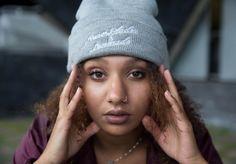 Rap artist Alia Zin wearing the RB&L Print grey beanie