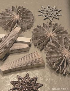 elements to make the gorgeous ornaments. Looks like they sliced old books.