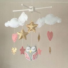 Baby mobile - Baby girl mobile - Cot mobile - Owl, clouds, hearts and stars mobile - Cloud Mobile - Nursery Decor - gold and pink. by EllaandBoo on Etsy https://www.etsy.com/listing/398553019/baby-mobile-baby-girl-mobile-cot-mobile