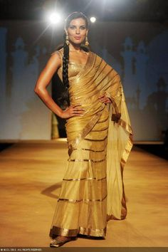 Deepti Gujral displays a creation by designers Ashima and Leena on Day 4 of India Bridal Fashion Week in New Delhi on July 25, 2013