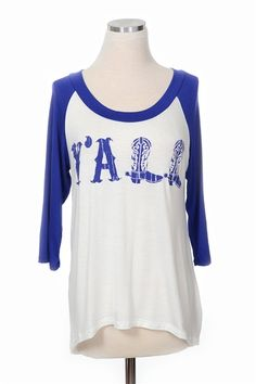Fall in love with our Y'all Tee! A baseball style tee with a crew neckline and high-low hem. We love this top with cut off shorts and your favorite sunnies!