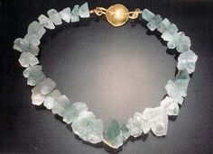 rough aquamarine and 22k gold work, by Michele Delville