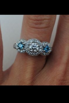 Pretty engagement ring with a tiffany blue diamond.